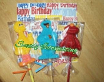 12 Sesame Street chocolate character lollipops. Elmo, Big Bird & Cookie Monster. party favors, Sesame street theme. Elmo party
