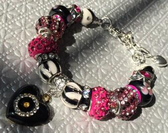 Fuschia and black crystal bead bracelet.