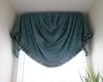 Teal striped, fringed , and lined damask valance for window cornice