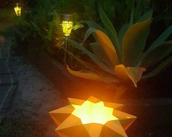 Origami Lanterns look great in the garden  comes in a pack of three for twenty dollars or one for eight dollars