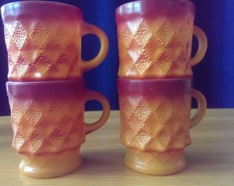 Set of 4 vintage Fire King orange stacking mugs