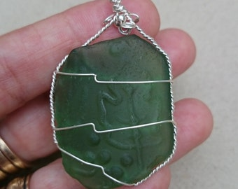Green patterned seaglass pendant wrapped in sterling silver wire