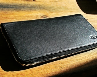 Black leather zipped clutch-wallet