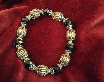 Silver and Black bracelet, Capped and twisted silver melons from Bali,Montana blue faced Czech crystal, woman's bracelet, evening bracelet