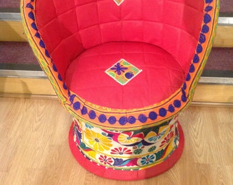 Wicker chairs covered in fantastic vintage fabric.