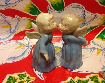 Vintage pair of hand painted ceramic kissing angel figurines