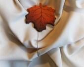 Maple leaf curtain holdba...