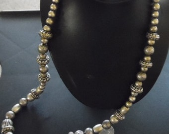 Nice, statement pc. Necklace, using very large pewter colored beads and spacers.