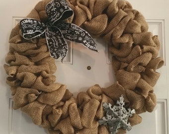 Burlap country chic holiday wreath with a metal snow flake ornament and a chalk print bow