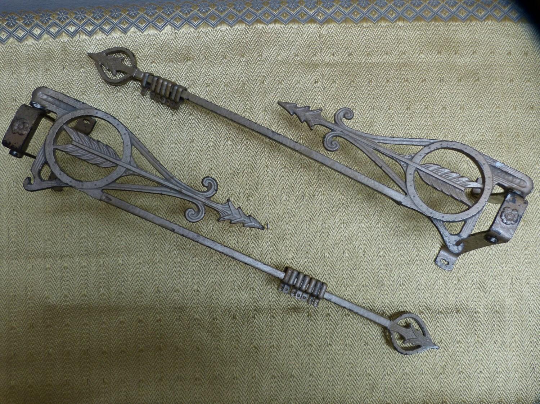 art nouveau deco cast metal swing arm curtain rods in