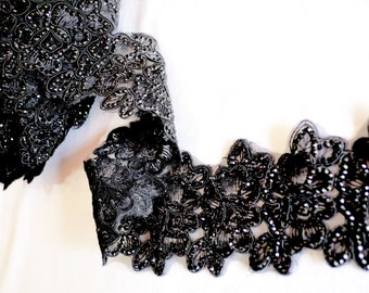 Finely detailed oversized and sequined black floral broad trim