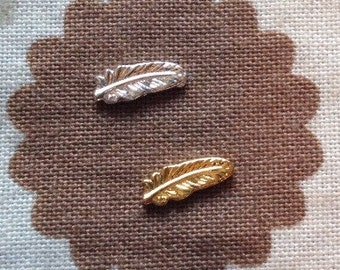 Small silver or gold feather floating charm