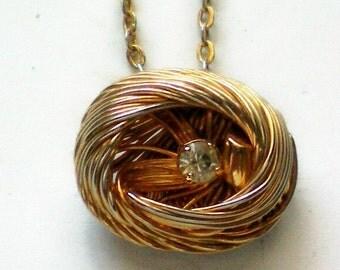 Tiny Gold tone Nest with Rhinestone Egg Necklace