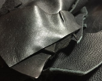 Black Leather Scraps/Remnants. Choose from 1 lb or 1.5 lb.
