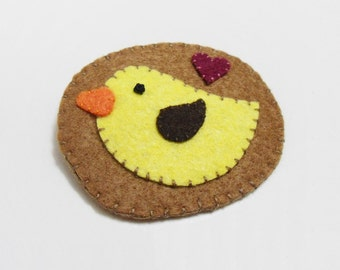 Bird brooch, yellow felt