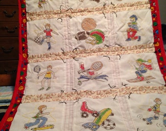 Hand tied & hand embroidered sports themed quilt