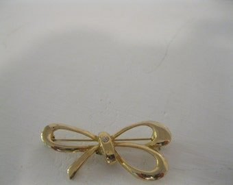 Gold Bow Brooch with diamonds