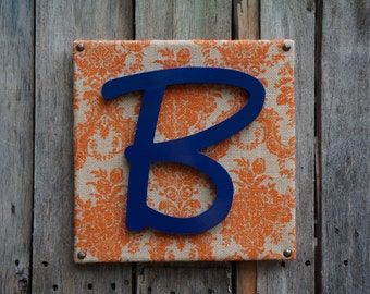 Orange damask canvas with the letter B