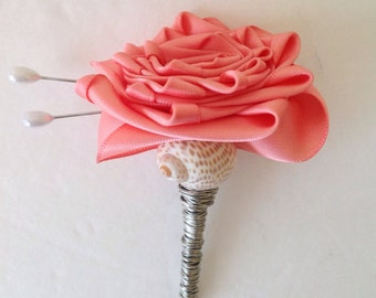 Custom Coral Satin Rose Boutonnière Lapel Flower Accented With A Shell And Silver Wire