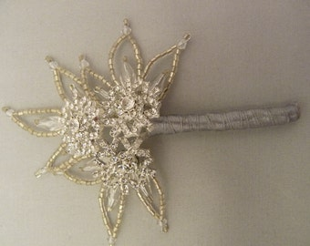 Snowflake corsage, snowflake boutonniere, buttonholes, mother of the bride, grooms, ushers.