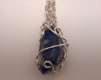 Beautiful silver wire wrapped polished blue stone