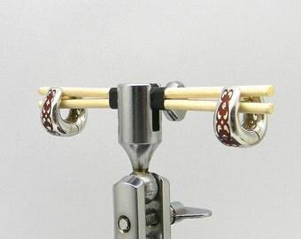 Sterling silver huggie earrings with 18K-posts, enameled pattern/pierced filigree