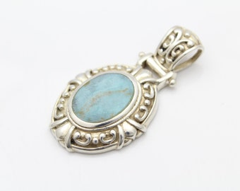 Large Ornate Tribal-Style Pendant in Turquoise and Sterling Silver. [10752]