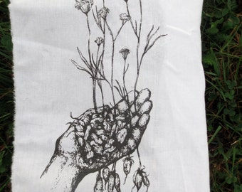 little roots back patch -- wild yampah roots and flowers held in our hands silkscreened orgininal drawing by amara hollow bones