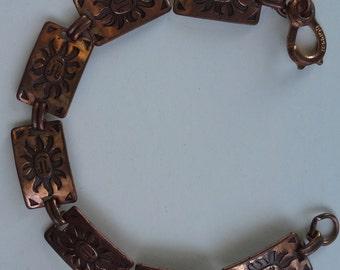Vintage copper stamped bracelet with links of smiling sun faces