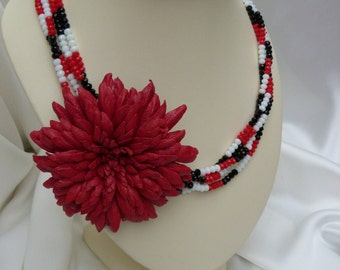 Leather flower necklace with shiny beads.