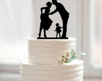 Bride, groom, and child wedding cake topper
