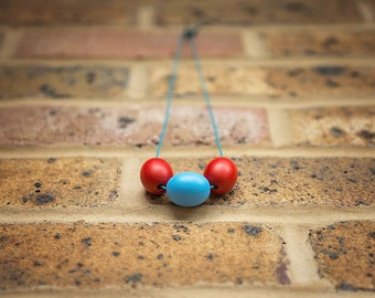 Toddler necklace, large wooden beads on leather cord, blue and red