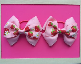 strawberry/pink hairbow on pony tail elastics