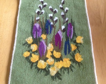 A beautiful wall hanging with the first spring flowers  Scandinavian Swedish  handwoven in flemish technique from 1970s.