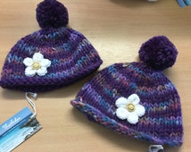 Soft Cosy Little Girls Hand Knit Bobble Hat With Knitted Flower And Wooden Logo Button