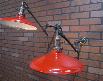 Pair of Vintage Industrial Articulating Arm Work Light Sconces With Red Gas Station Porcelain Enamel Shades
