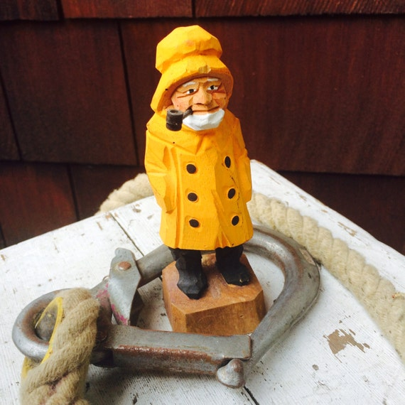 Yellow fisherman wood carved sea captain with pipe nautical