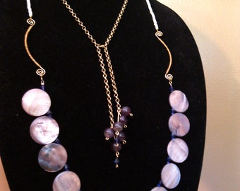 multi-stranded gold-colored amethyst and shell necklace