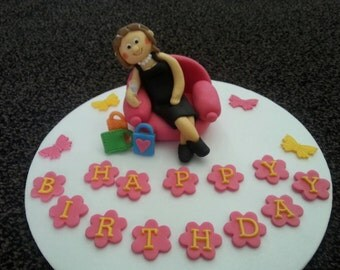 Edible handmade drunk lady with champagne glass and shopping bags birthday/ retirement cake topper