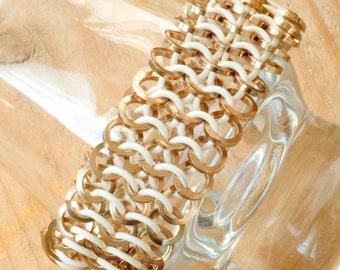 Bracelet-handwoven-champagne & white rubber aluminium