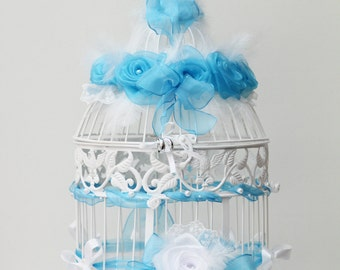 Cage marriage with flowers lace urn feathers pearls and ribbons