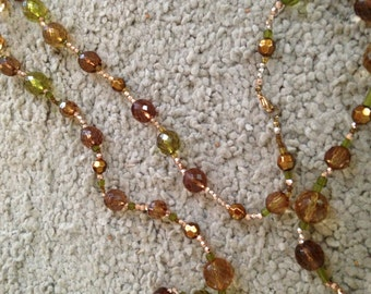 Luminescent Brown and Green Beaded Necklace