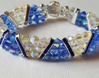 Bracelet of 6mm bicones in triangles, the crystal AB separated by silver spacers with blue crystals from blue AB bicones. Fancy silver clasp