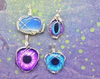 Wire Wrapped glass eyes and opalite cabochon pendant set.