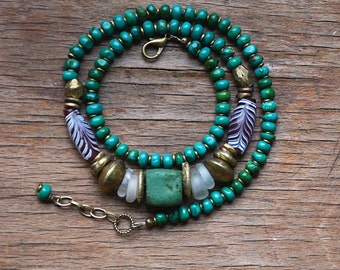 Teal Hebron bead necklace with antique Venetian feather beads, clear European donuts and turquoise, trade bead necklace