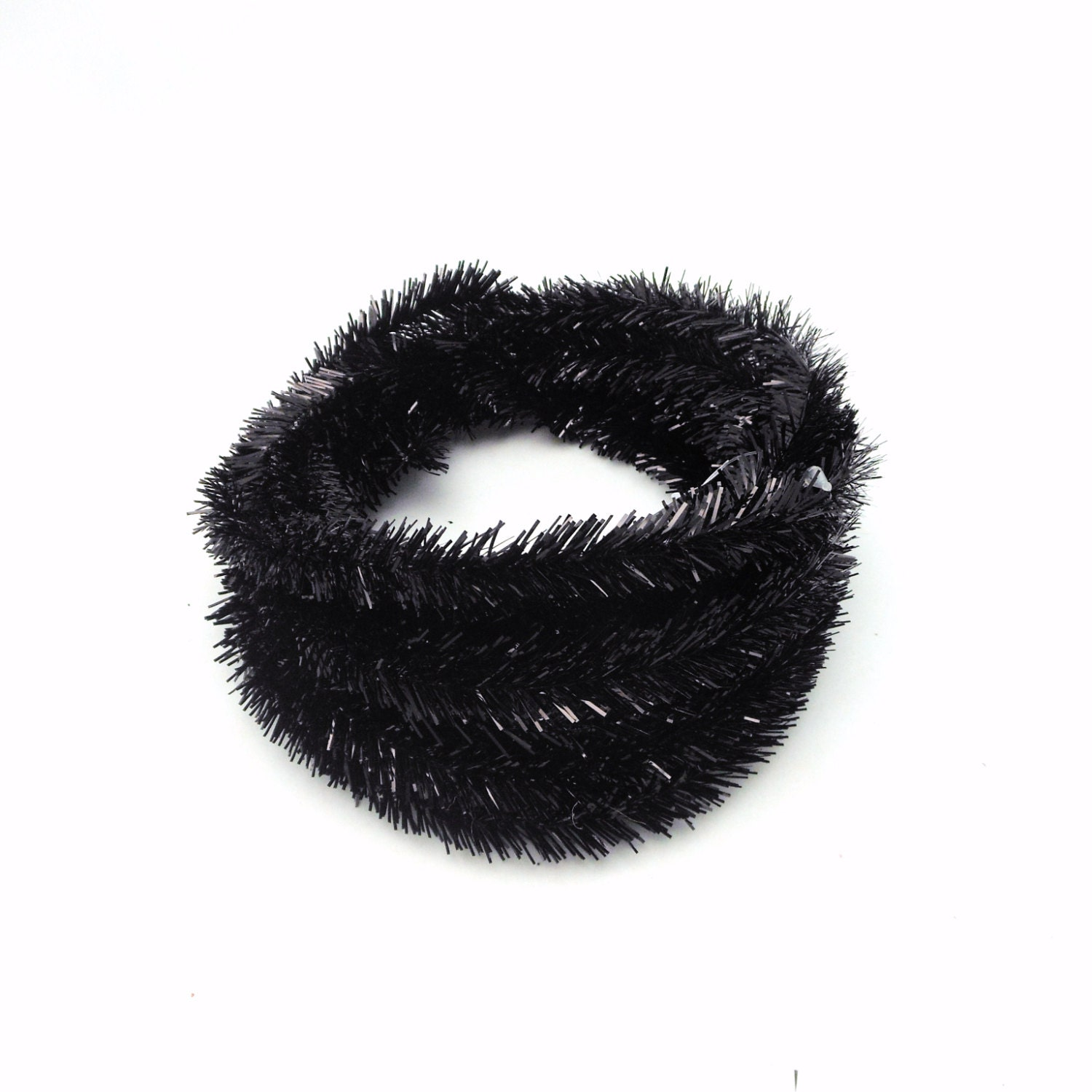 Roll of metallic black wired tinsel garland feet from