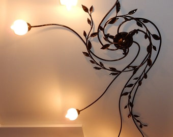 Wrought iron chandelier with floral ornaments