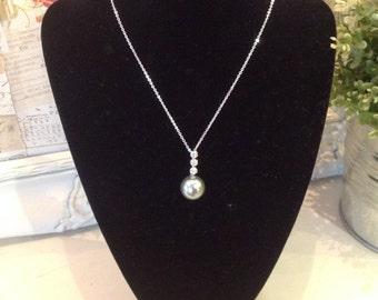 White gold plated necklace with grey pearl pendant and crystals