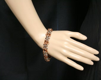 Copper and stainless steel chainmaille bracelet.