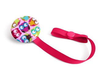 Attached to pacifiers pink owls